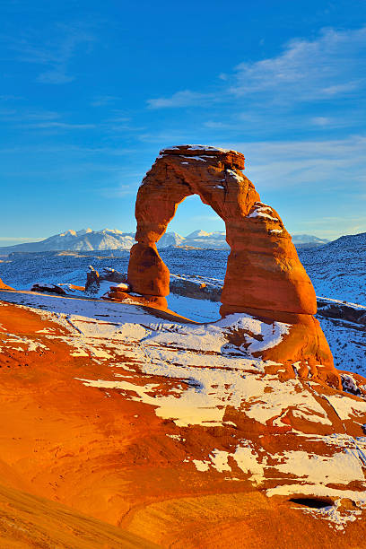 delicate arch at sunset - turret arch stockfoto's en -beelden