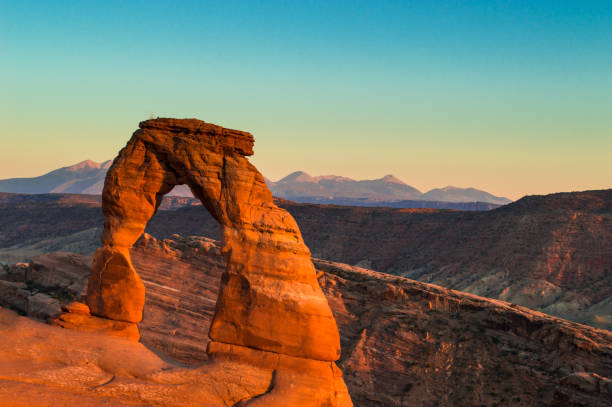 Delicate Arch Desert Sunset - Arches National Park - Utah - United States Southwest Delicate Arch Desert Sunset - Arches National Park - Utah - United States Southwest delicate arch stock pictures, royalty-free photos & images