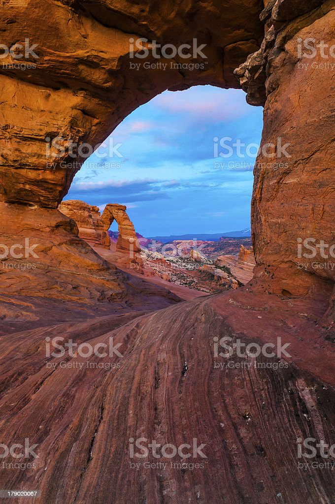 Delicate Arch framed by another one royalty-free stock photo
