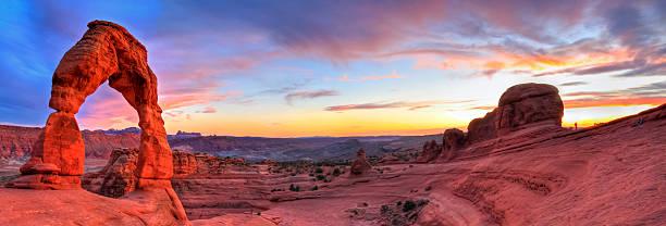 """Delicate Arch HDR Sunset Panorama """"Sweeping sunset panoramic view of famous Delicate Arch in Arches National Park in Moab, Utah (HDR)."""" arches national park stock pictures, royalty-free photos & images"""