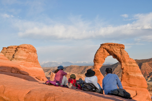 Watching The Sunset On Delicate Arch Stock Photo - Download Image Now
