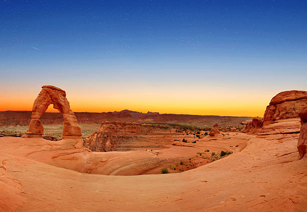 Delicate Arch Panoramic view of Delicate Arch in Arches National Park, Utah, U.S.A. delicate arch stock pictures, royalty-free photos & images