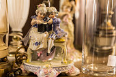 Delicate figurine of mother and daughter with blurry background
