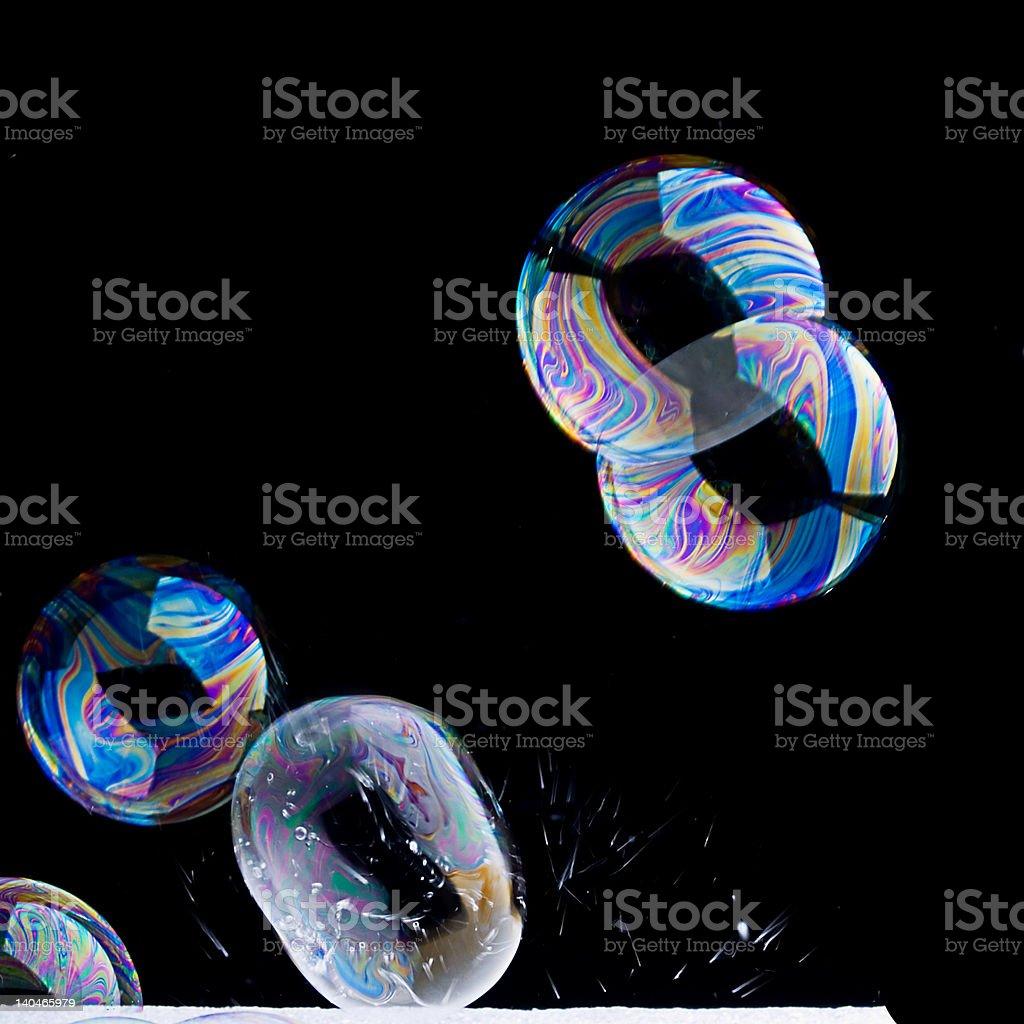 Delicate Iridescent Bursting Bubbles stock photo