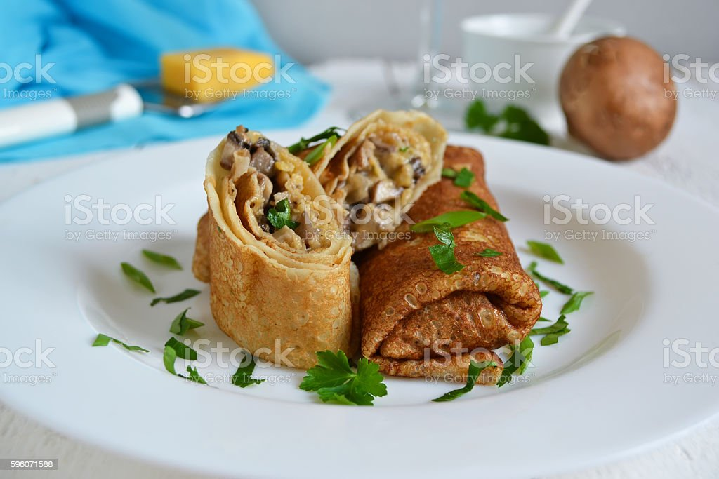 Delicate pancake stuffed with mushrooms and cheese royalty-free stock photo
