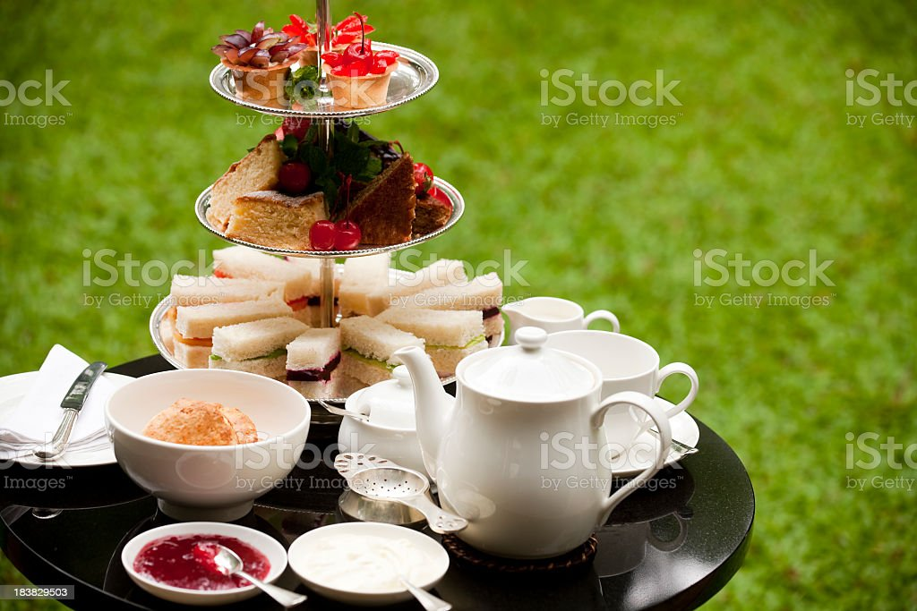 Delicate traditional afternoon tea arrangement stock photo