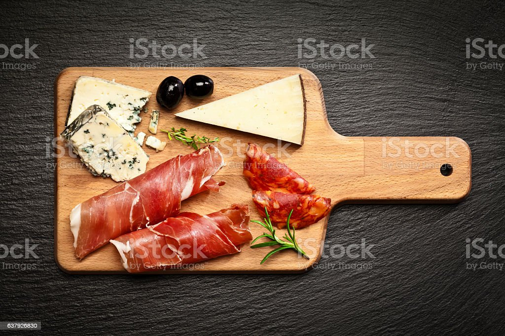 Delicatessen: Prosciutto and cheese stock photo