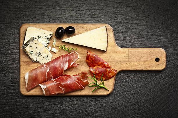 delicatessen: prosciutto and cheese - salami vorspeise stock-fotos und bilder
