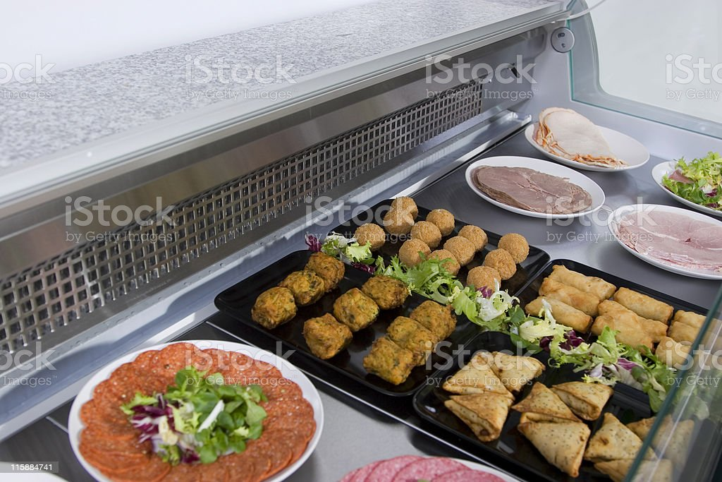 Delicatessen refrigerated food counter display royalty-free stock photo