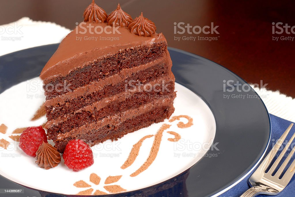 Delicious 4 layer chocolate cake with raspberries royalty-free stock photo