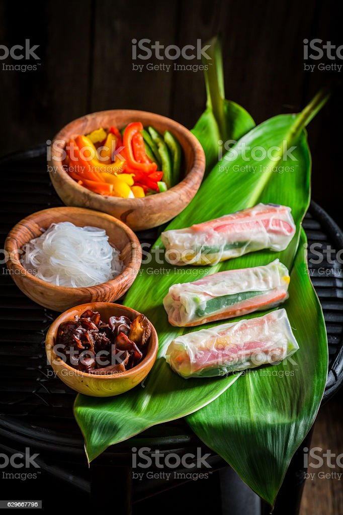 Delicious and fresh spring rolls on green leaf stock photo