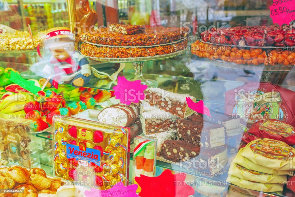 Delicious and fresh sweets in the shop window. stock photo