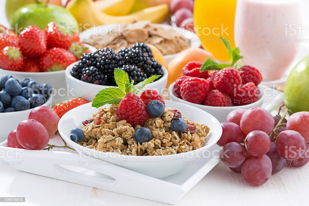 Delicious and healthy breakfast with fruits, berries, cereal stock photo