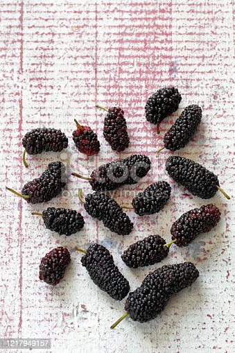 istock delicious and healthy mulberries on pink table 1217949157
