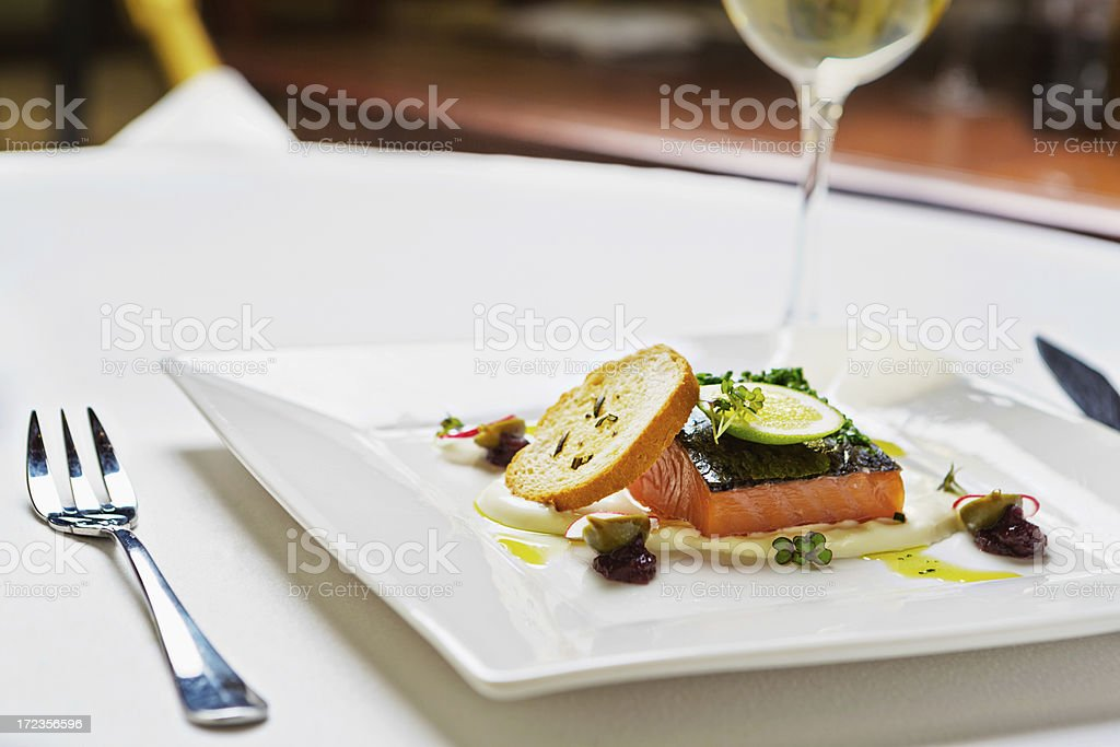 Delicious and healthy restaurant entree of salmon wth white wine royalty-free stock photo
