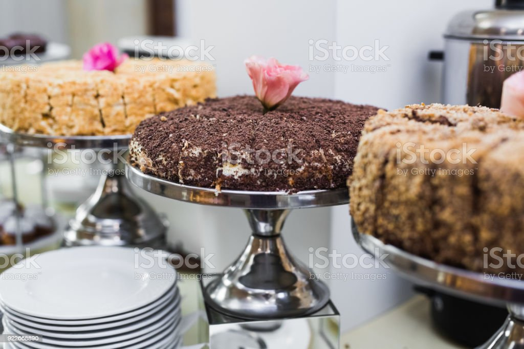 Delicious and tasty dessert table with cupcakes shots at reception closeup stock photo
