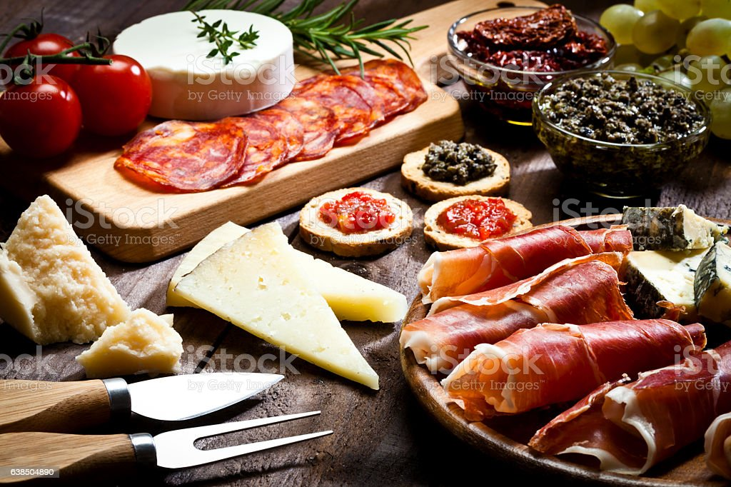 Delicious appetizer on rustic wood table - foto de acervo