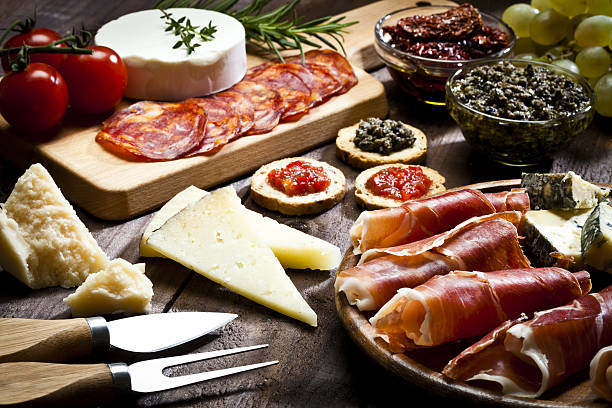 delicious appetizer on rustic wood table - delicatessen - fotografias e filmes do acervo