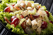 istock Delicious appetizer Sonoma salad with chicken breast, celery, pecans and grapes covered with sauce close-up on a plate. horizontal 1166230605