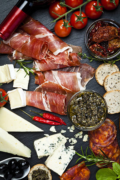 Delicious appetizers on dark slate table stock photo