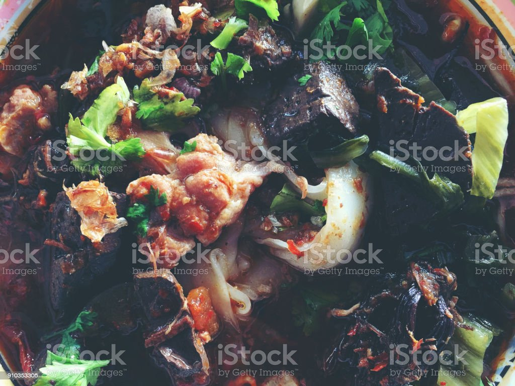 Delicious Asia.  Local Thailand Food. Rice noodles with spicy pork sauce. Thai Northen style food. vintage tone stock photo