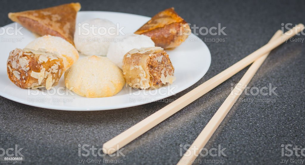 Delicious assortment of homemade Asian pastries. Samosa  and banana balls stock photo