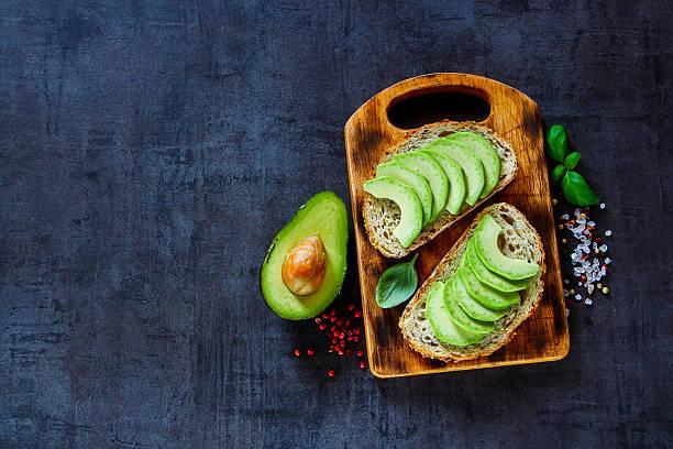 Delicious avocado bruschetta stock photo