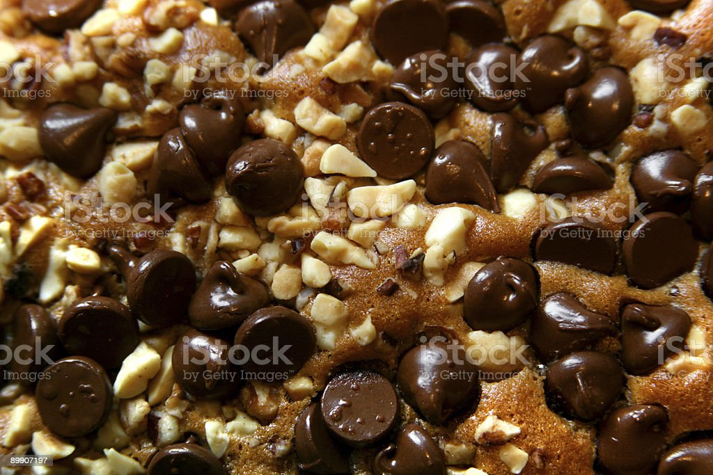 Delicious: Background of brownies topped with nuts and chocolate chips royalty-free stock photo