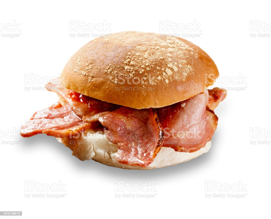 delicious bacon roll shot on white, and cut out with a drop shadow stock photo