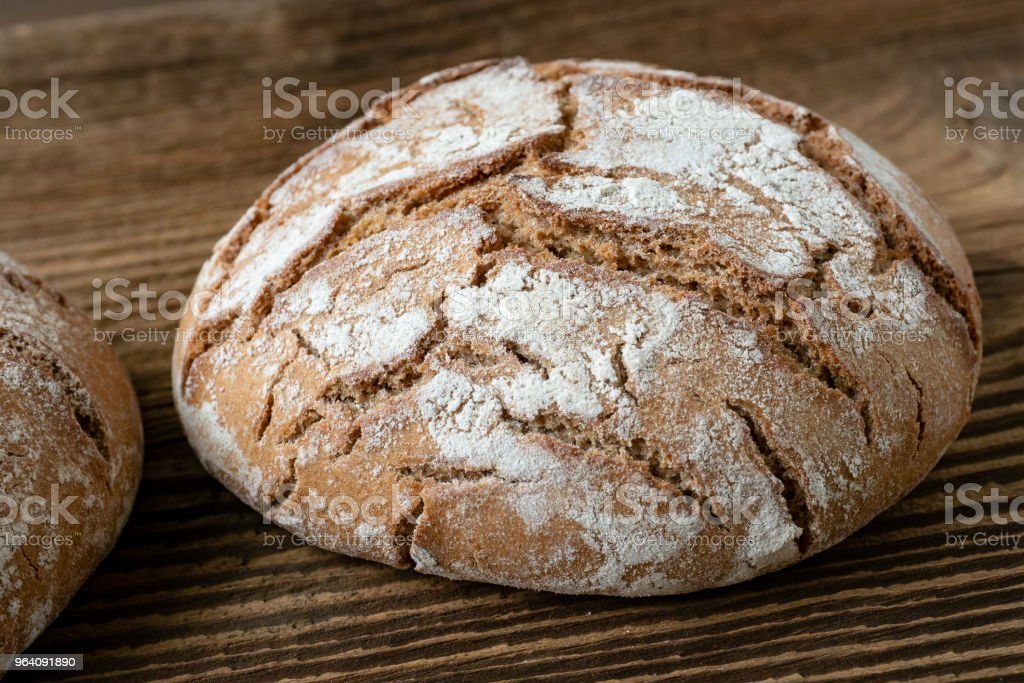 Delicious baked bread on a wooden background - Royalty-free Baked Stock Photo