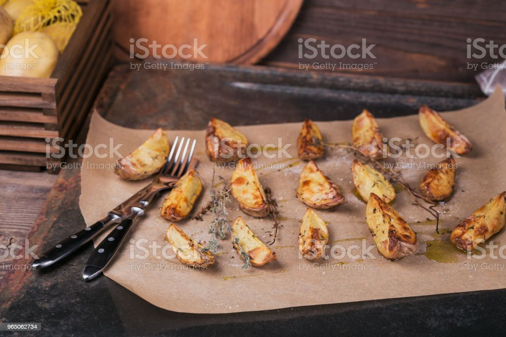 Delicious baked potatoes with herbs and salt royalty-free stock photo