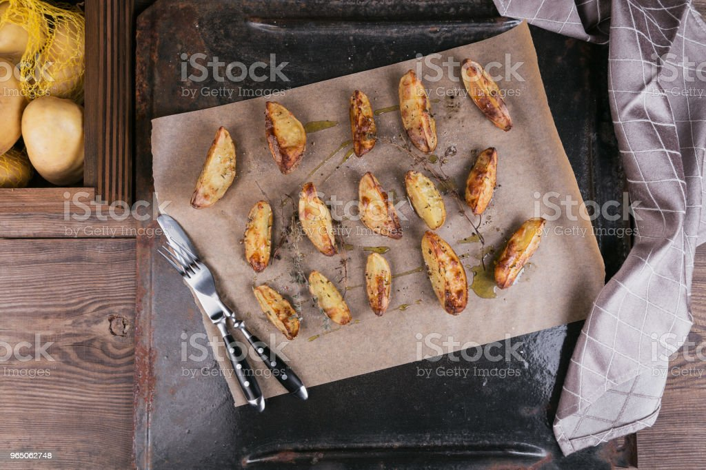Delicious baked potatoes with herbs and salt zbiór zdjęć royalty-free