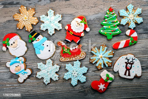 Delicious beautiful Christmas gingerbread cookies on wooden rustic table