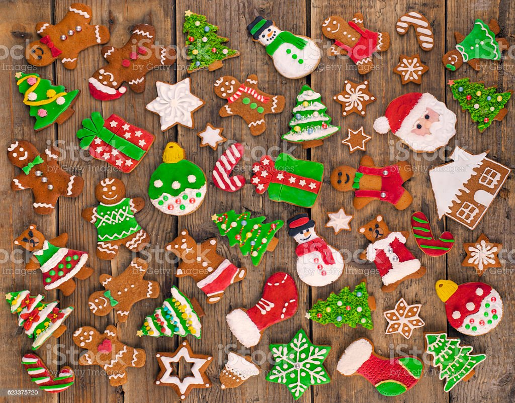 Delicious beautiful Christmas gingerbread cookies on wooden table. stock photo