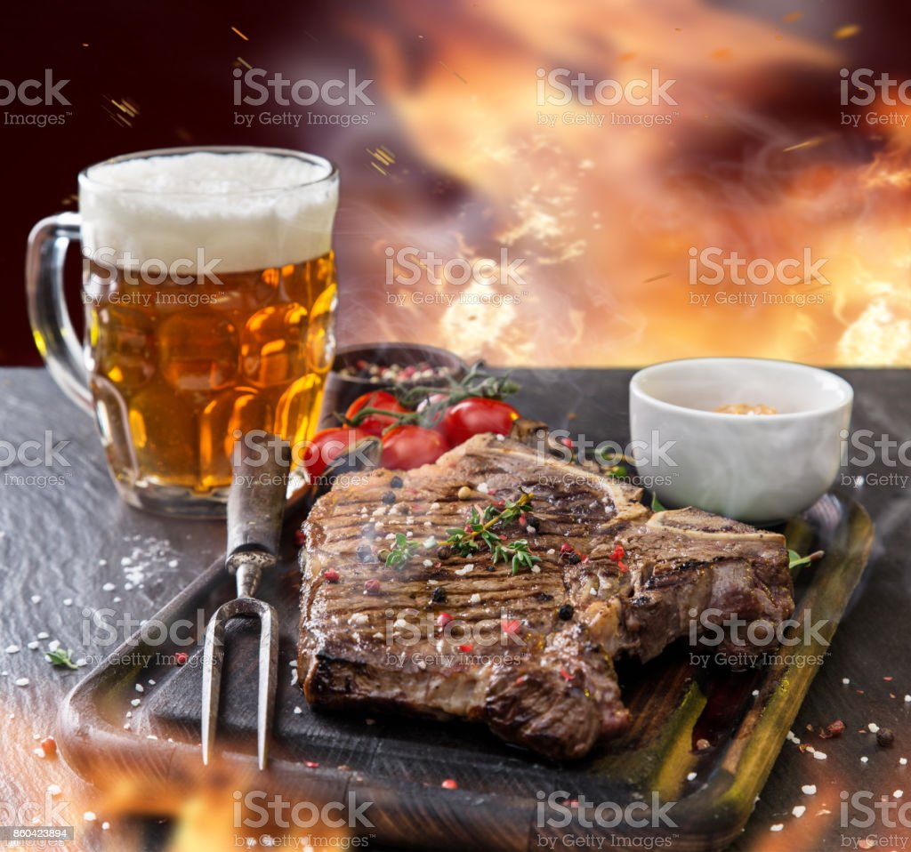 Delicious beef steak on black stone table stock photo
