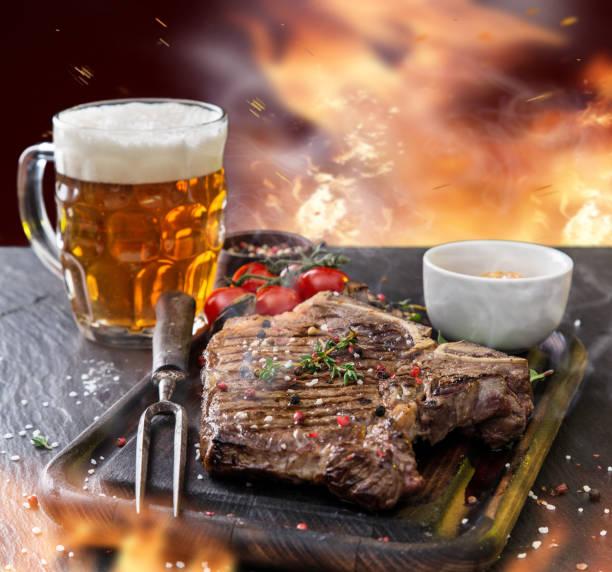 Delicious beef steak on black stone table stock photo