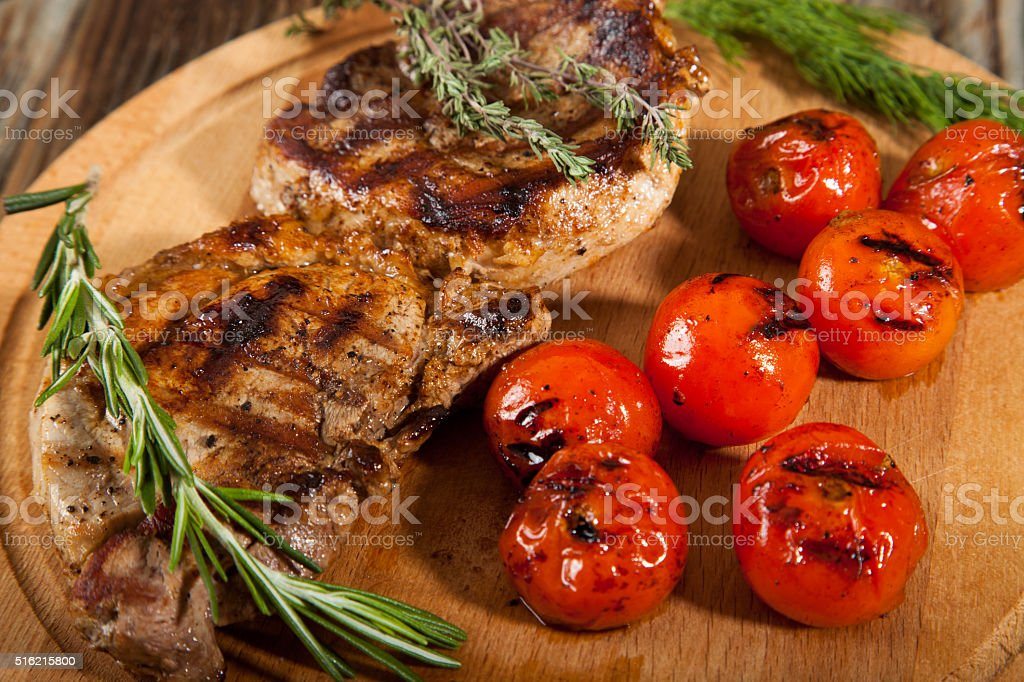 Delicious beef steaks on wooden table stock photo