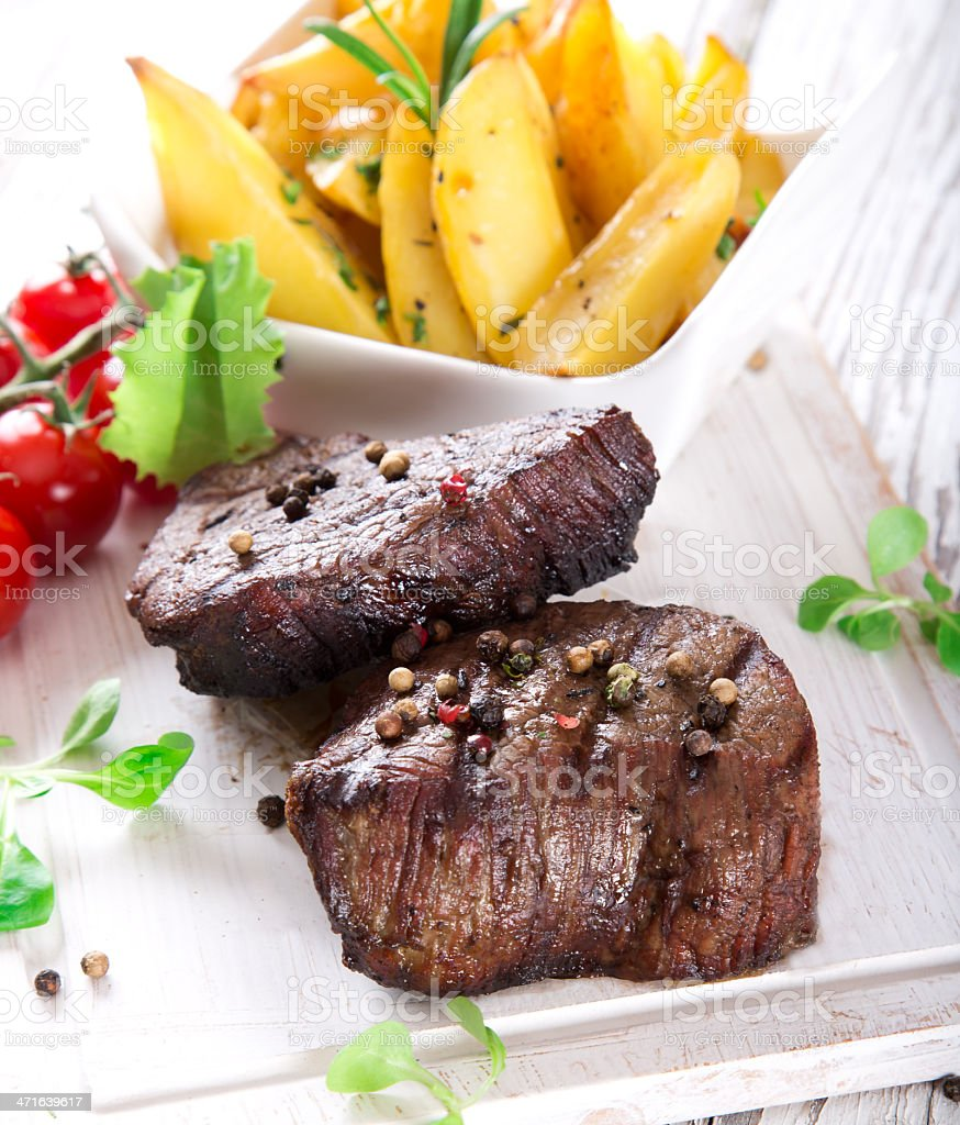 Delicious beef steaks royalty-free stock photo