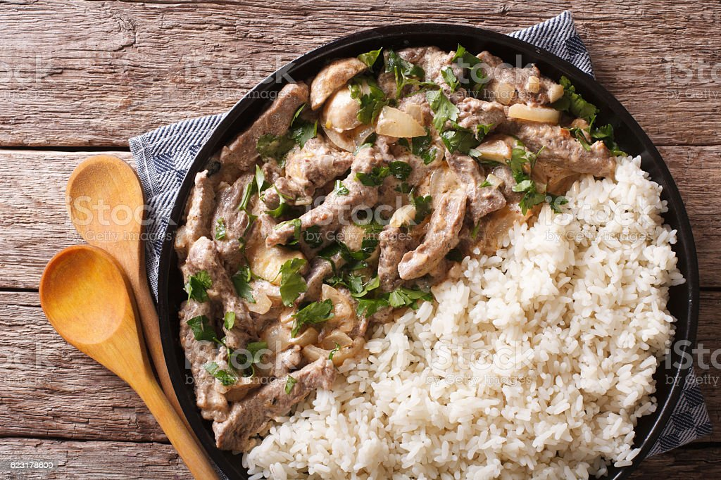 Delicious beef stroganoff with rice close-up. horizontal top view stock photo