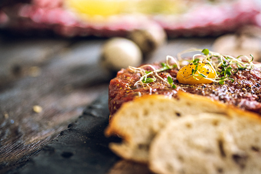 Delicious Beef tartare with quail egg and spices