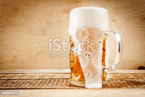 istock delicious beer on a wooden table 648913210