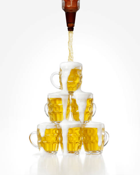 delicious beer - beer pour stock photos and pictures