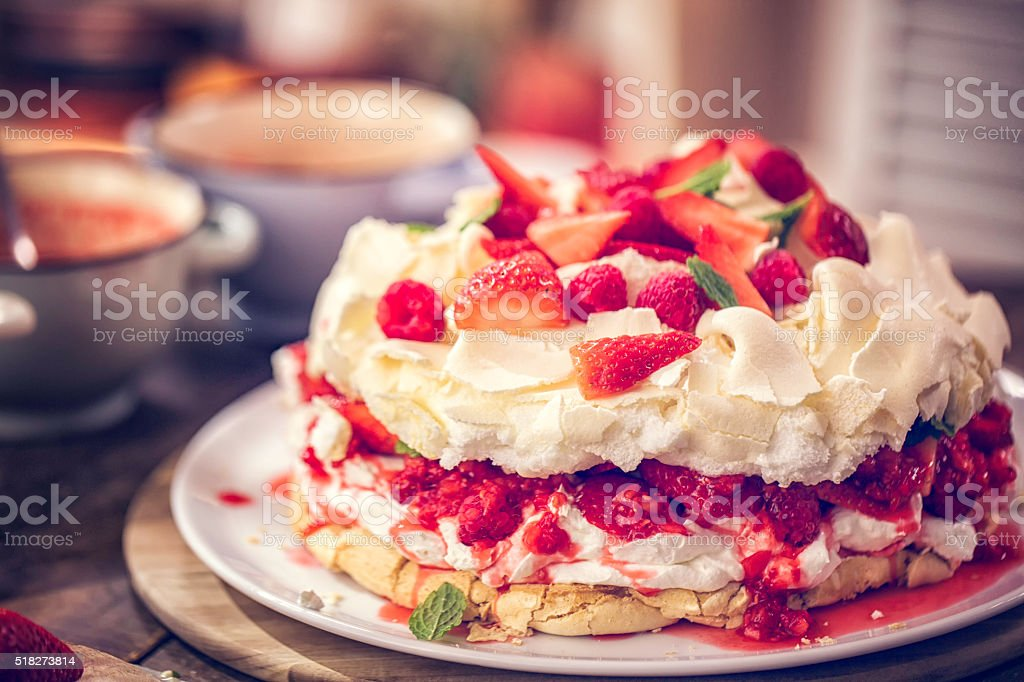 Delicious Berry Pavlova Cake with Strawberries and Raspberries stock photo