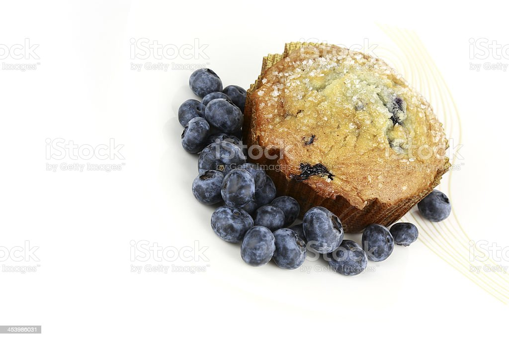 Delicious big blueberry muffin with fresh blueberries royalty-free stock photo