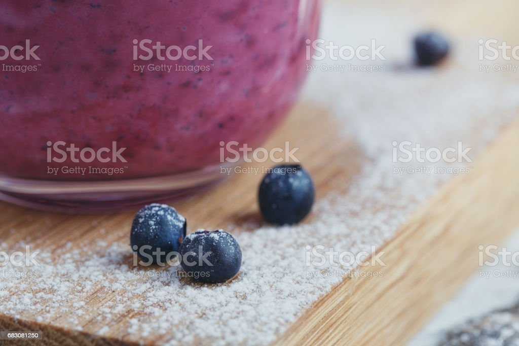 Delicious bilberry smoothie with fresh berries. Fresh yogurt with bilberry. Healthy breakfast. foto de stock royalty-free