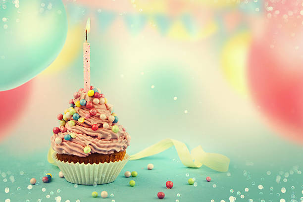 delicious birthday cupcake on table. - feengeburtstag stock-fotos und bilder