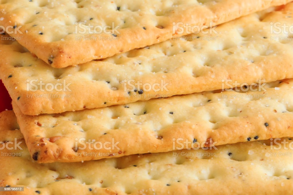 Delicious biscuits in stack. Stack of Graham Crackers Close Up on the Edges. Multigrain healthy crackers picture in macro key. stock photo