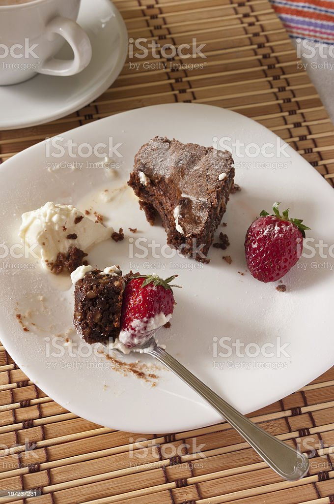 Delicious Bite of Chocolate Brownie and Strawberry with Whipped royalty-free stock photo
