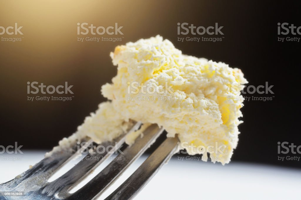 Delicious bite-sized portion of cheesecake on a fork - Royalty-free Cheesecake Stock Photo