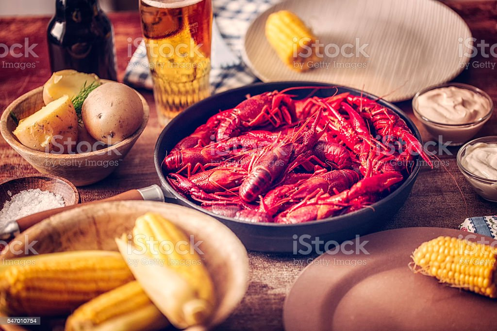 Delicious Boiled Red Crayfish with Sweet Corn and Potatoes stock photo